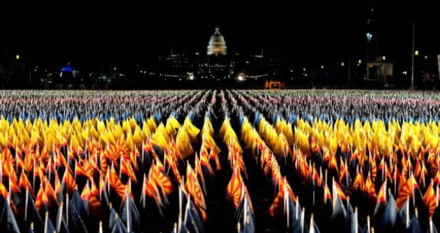 "The ""field of flags"" on the national mall as the US Capitol Building ahead of the inauguration of Joe Biden DC. photograph: Timothy Clary"